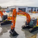 Clean and new excavators side by side ready to be deployed.