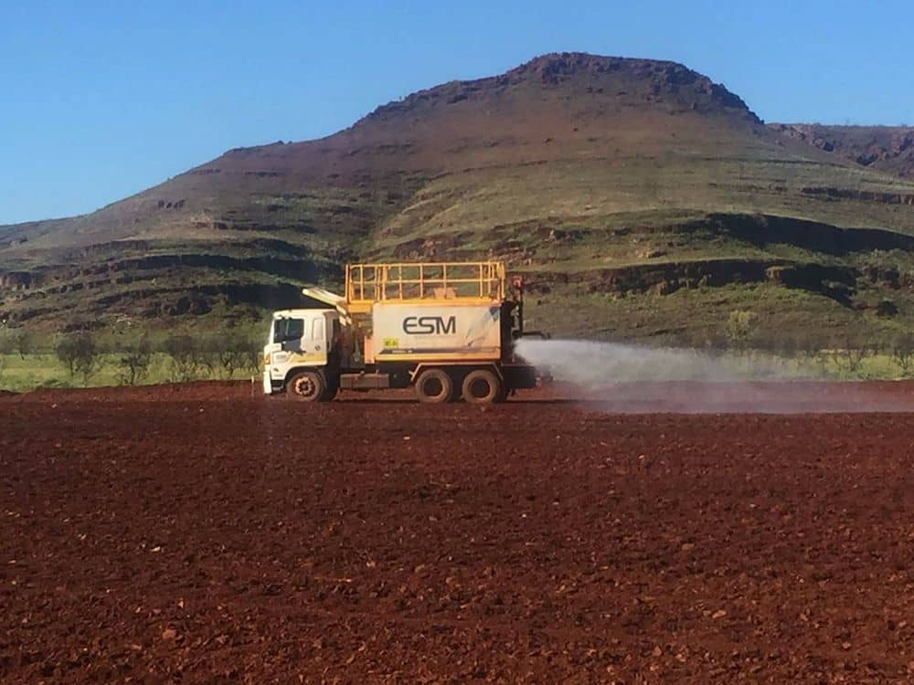 A water cart busy spraying dirt in the Pilbara WA.