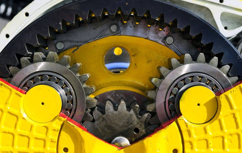 Cross section of dozer drive gear showing sprocket and bearings.