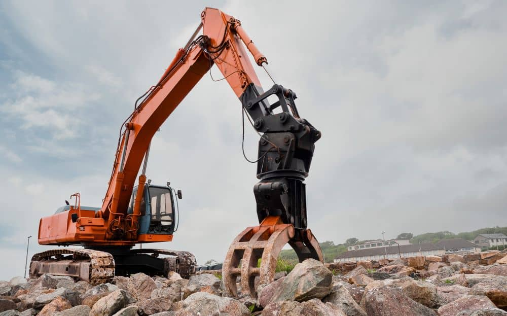 The grab or the grappler is used to pick up and move heavy objects in the worksite.